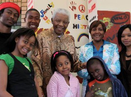 This handout picture taken on August 17, 2009 shows Nelson Mandela and his family (Back row L-R): great-grandson Thembela Mandela, grandson Mbuso Mandela, granddaughter Ndileka Mandela and Zoleka Mandela, (front row L-R): Zenani Mandela (in green), Bohelo Seakamela, and great-grandson Zwelami Mandela. Source: AFP